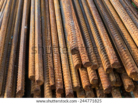 Stack of the metal rusty reinforcement bars. - stock photo