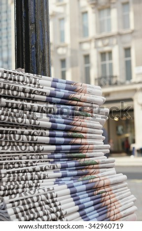 stack of the newspapers in the city , London , financial capital of Europe - stock photo