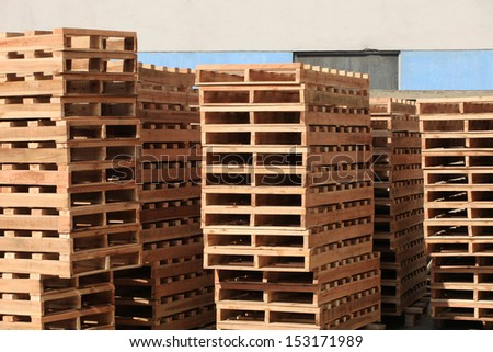 Stack of the wooden pallet in warehouse - stock photo