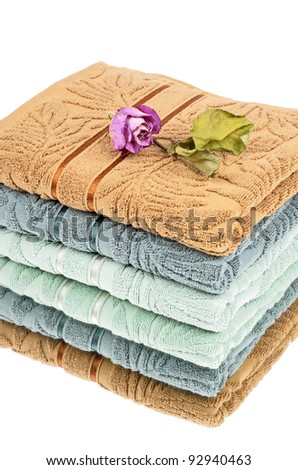 Stack of three bath towels of different colors,reflection