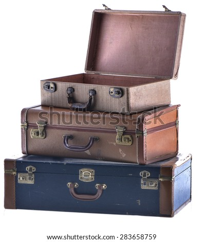 Stack of Three Vintage Suitcases Angled Open Isolated Two - stock photo
