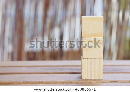 Stack of three wooden generic toy cubes
