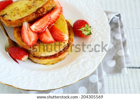 stack of toast with honey and strawberries, food