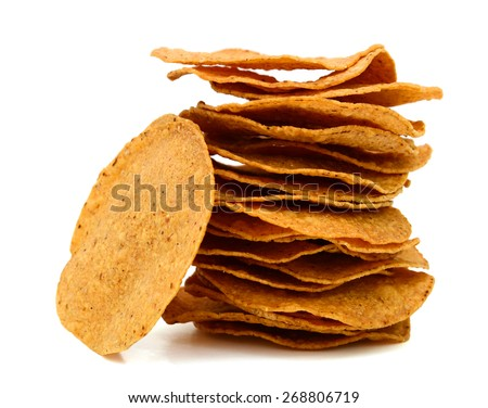 stack of tortilla chips isolated on white  - stock photo