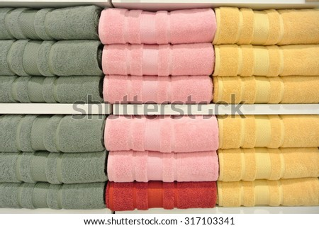 Stack of towels in the closet or shelf as Background - stock photo