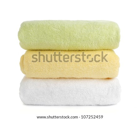 stack of towels isolated on white background - stock photo