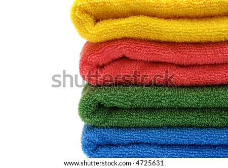 stack of towels on white background with copyspace - stock photo