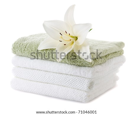 stack of towels with white lily isolated on white background - stock photo