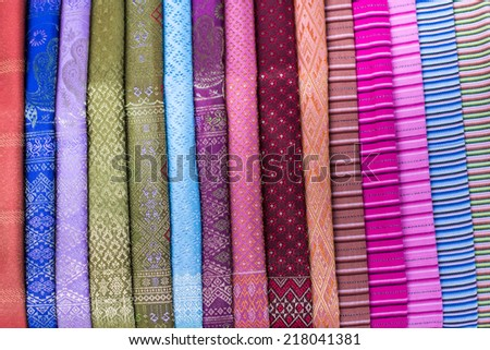 stack of traditional colourful sarong in the shop. for a background. - stock photo