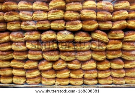 Stack of traditional German doughnuts in a Bakery - stock photo