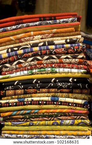 Stack of traditional Indian hand-printed fabrics at a local market - stock photo