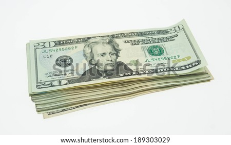 stack of twenty dollar bills isolated on white - stock photo