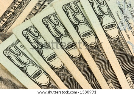 Stack of twenty dollar bills on white background.