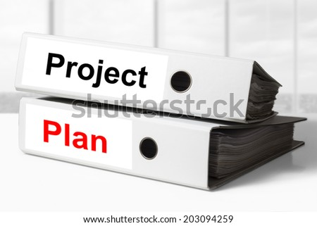 stack of two white office binders project plan - stock photo