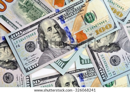 Stack of 100 US Dollar banknotes - stock photo