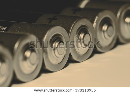 Stack of used batteries - stock photo