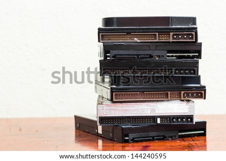 Stack of used hard disks - stock photo
