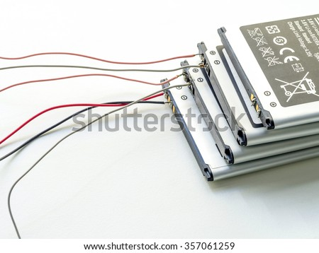 stack of used lithium-iron battery with wire, the battery removed from mobile phone - stock photo