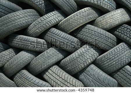 Stack of used tires waiting for recycle - texture background - stock photo