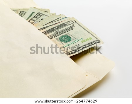 Stack of used $20 US currency bills or notes in an envelope in a concept photo for a bribe or payment - stock photo