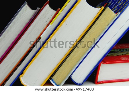 stack of various books - stock photo