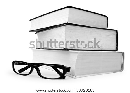 Stack of various books and glasses on white background - stock photo