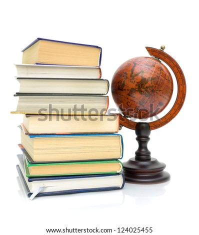 stack of various books and vintage globe isolated on a white background close-up - stock photo
