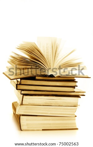 Stack of various books isolated on white background. Toned image. - stock photo