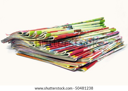 Stack of various multicolored magazines on white background - stock photo