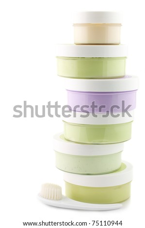 Stack of various SPA cosmetics isolated on white background. - stock photo