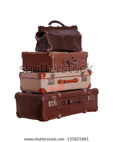 stack of very old suitcases - stock photo