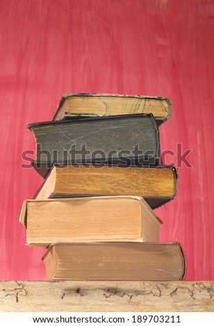 stack of vintage books free copy space - stock photo