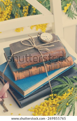 stack of vintage old books  on table, retro toned - stock photo