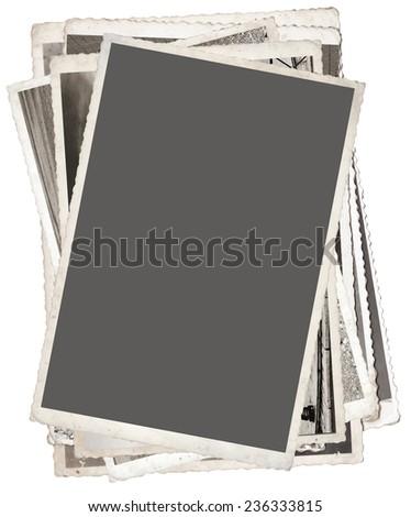 Stack of Vintage photos isolated on white background - stock photo