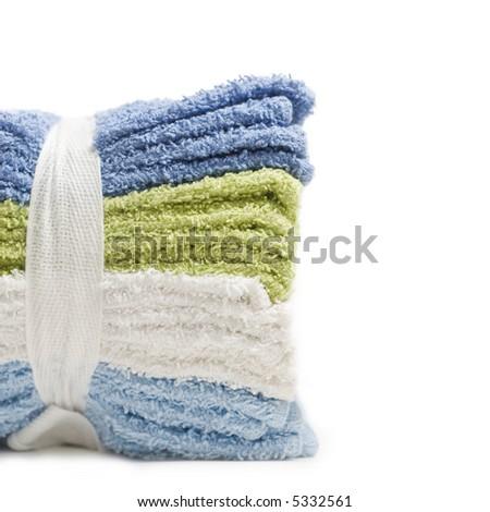 Stack of washcloths close up isolated on white - stock photo