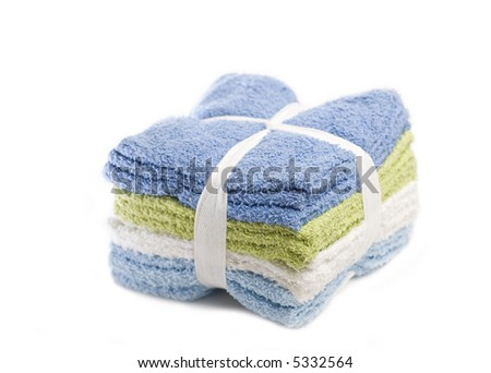 Stack of washcloths isolated on white - stock photo