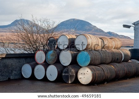 Stack of whisky barrels outside of distillery