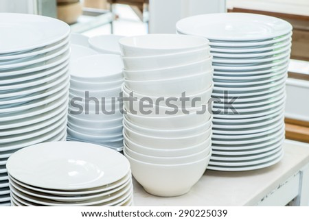 Stack of white ceramics plate and bowl - stock photo