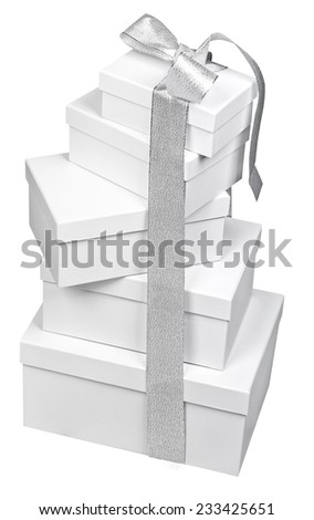 Stack of white gift boxes tied together with silver ribbon bow, isolated on white - stock photo