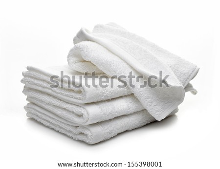Stack of white hotel towels isolated on a white background - stock photo
