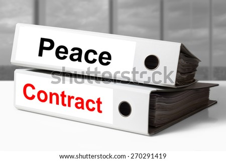 stack of white office binders peace contract - stock photo