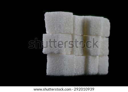 Stack of White Sugar Cubes on black background - stock photo