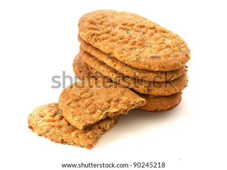 Stack of whole grain biscuits on white background - stock photo