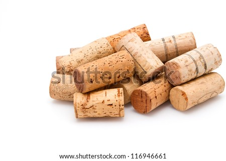 Stack of wine corks on white background - stock photo
