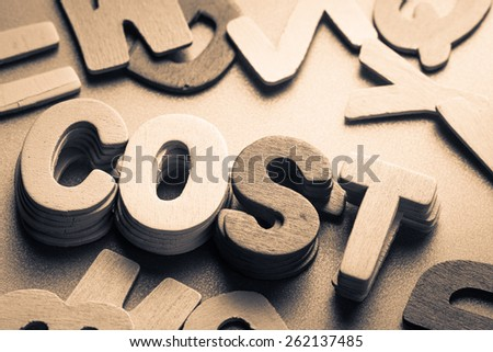 Stack of wood letters as Cost word - stock photo