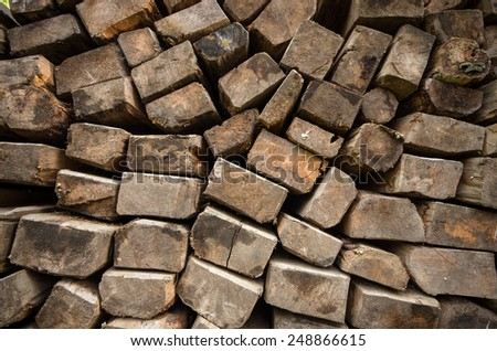 Stack of wood logs background texture - stock photo