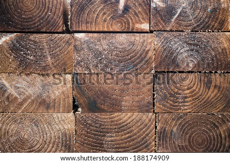 Stack of wood planks textures in lumber yard - stock photo