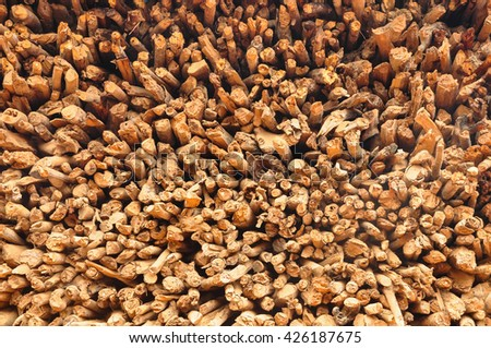 Stack of wooden firewood - stock photo