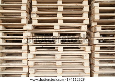 Stack of wooden pallets with selective focus - stock photo