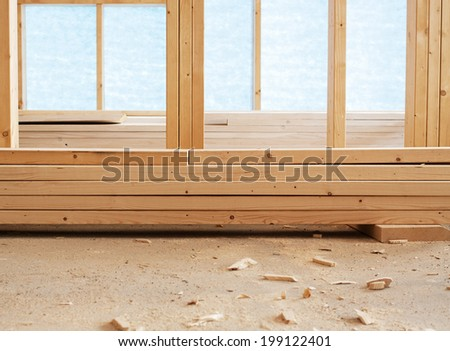 Stack of wooden planks inside house - stock photo
